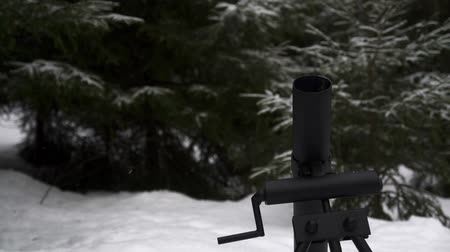 salvo : Mortar fires a shell in the winter snowy forest