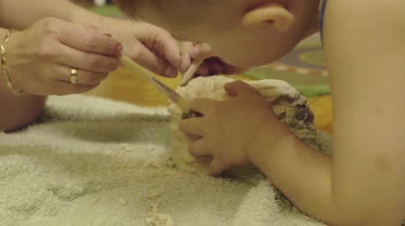 hoard : family playing in the archeology destroys the plaster to get the skeleton. archaeological excavations Stock Footage