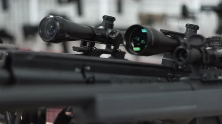 sniper scope : Gun with an optical sight stands on the bipod on the floor Stock Footage