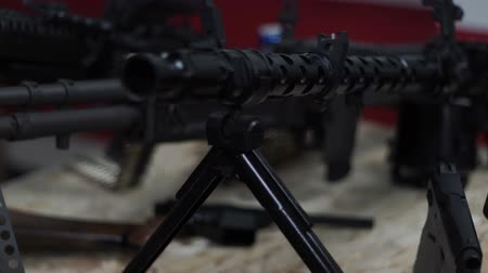 sniper scope : The machine-gun is on the bipods on the floor