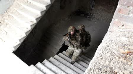 special police : Military men with arms defend the building and go up the stairs