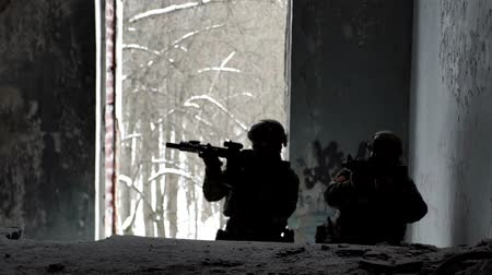 gunshot : Military men with arms defend the building and go up the stairs