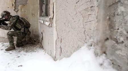 gunshot : Military men with arms defending the building in winter