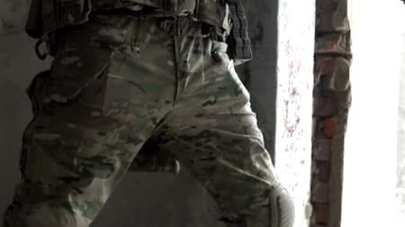 gunshot : Military men with arms defending the building Stock Footage