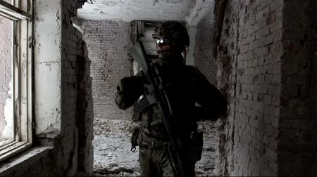 special police : Military men with arms defending the building Stock Footage