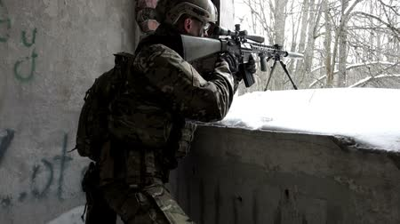 guns : Military men with arms defending the building in winter