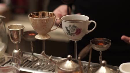brew tea : Traditional tea ceremony in bar. Original cups with tea