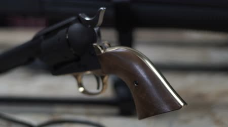 калибр : Black drum revolver with a wooden handle. Weapon pistol. Black handgun.