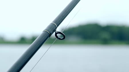 fishing pole : Fishing rod on background river and wildlife. Fishing equipment