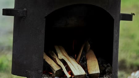 smoked : Bonfire under tourist cauldron. Fire burns for cooking in a cauldron Stock Footage