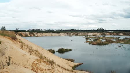 shores : Panoramic view sand quarry. Lake among sandy shores quarry