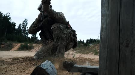 storming : Close up military soldier on sand. Soldiers fighting. Military gear