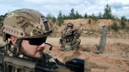 guns : Military soldiers with weapons in ambush communicate gestures