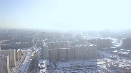 townhouse : Modern residential buildings in winter city drone view. City infrastructure in modern town and road for car traffic aerial view.