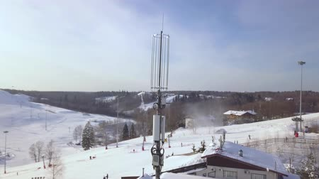 микроволновая печь : High tower with antennas for mobile wave in winter ski resort. Drone view mobile phone communication repeater antenna. Mobile phone network antenna.