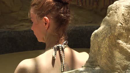 mud bath : Relaxing woman bathing in mud bath in spa resort. Young woman pouring body by mud in spa bath. Beauty therapy and skin care concept. Healthy and wellness lifestyle.