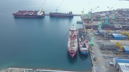 přístav : Aerial landscape cargo ship in industrial shipyard. Sea ships standing on parking lot in dockyard drone view.