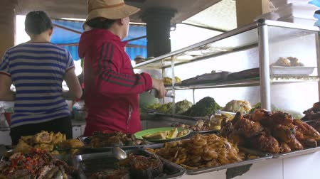 проданный : Hanoi, Vietnam - july, 2018: cooked asian food on Vietnamese market. Traditional vietnamese food sold on market.