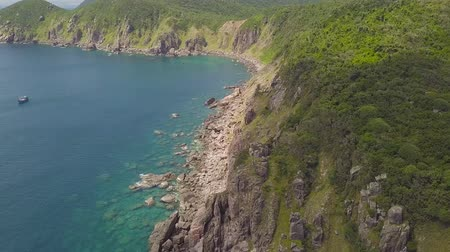 Landscape mountain cliff and sea ships sailing in blue drone view. Beautiful landscape from drone ships sailing in blue sea and rocky cliff on horizon. Stock mozgókép