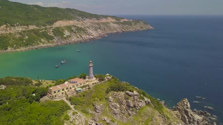 Light house on edge on cliff with beautiful sea landscape aerial view. Drone view sea lighthouse on mountain and blue water on skyline landscape.