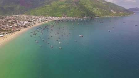 Aerial view sailing ships standing on parking lot in blue sea. Beautiful landscape fishing boat in sea harbor and green mountains landscape. Wideo