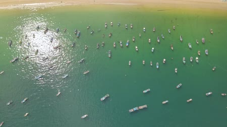 Sailboats and ships standing in blue sea near shore aerial view. Fishing boats and sailing ships in sea port drone view. Wideo