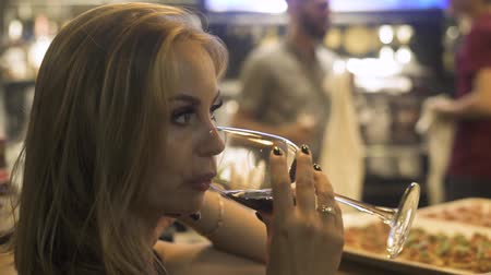Portrait woman drinking red wine from wineglass in bar. Woman drinking red wine from glass at event party in restaurant. Wideo