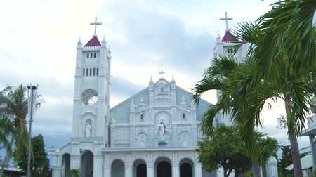 cruzes : Facade catholic cathedral with statue Virgin Mary and Jesus Christ. Religious architecture Catholic Church with crosses and statue Holy Virgin Mary. Vídeos