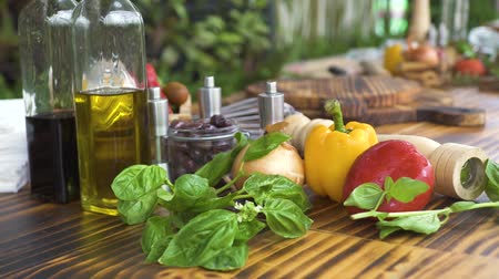 ocet : Vegetable background on wooden kitchen table close up. Fresh vegetable, basil herb, olive oil, seasoning for mediterranean cuisine. Ingredient for preparation vegetarian salad.