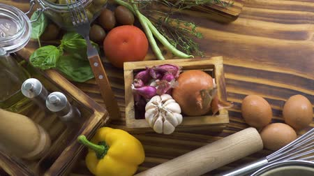 apetitoso : Food composition from colorful vegetables, eggs, flour for cooking italian spaghetti top view. Ingredient pepper, tomato, eggs and flour for mediterranean cuisine. Food background closeup. Stock Footage