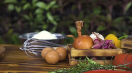 apetitoso : Fresh ingredient for cooking pasta close up. Food composition tracking shot. Vegetables, seasoning, flour, eggs, cheese for italian pizza on wooden table. Medeterranean cuisine concept.