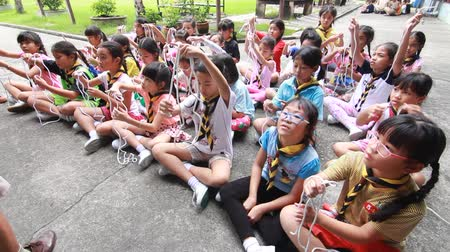 scout : Scout learn usage rope, Scout Camp in primary school Bangkok Thailand. Stock Footage