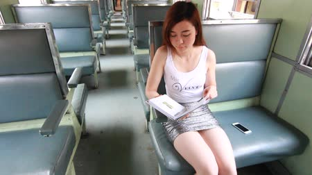 kifejlett : Portrait of thai adult beautiful girl read a book, Leisure travel by rail Stock mozgókép