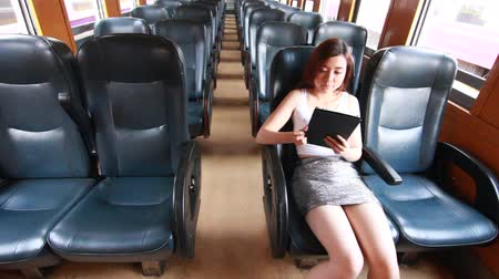 train workers : Portrait of thai adult beautiful girl using her tablet, Leisure travel by rail