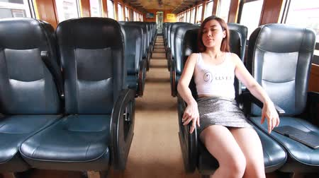 релаксация : Portrait of thai adult beautiful girl relax and sleep, Leisure travel by rail