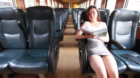 train workers : Portrait of thai adult beautiful girl read a book, Leisure travel by rail Stock Footage