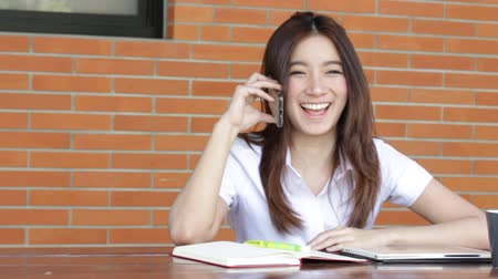 uniforme : Portrait of thai adult student university uniform beautiful girl calling smart phone