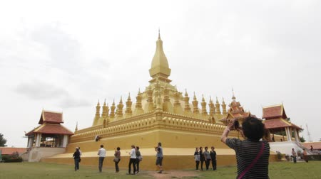 vientiane : VIENTIANE, LAOS - April 29: Pha That Luang is a gold-covered large Buddhist stupa and be the most important national monument in Laos and a national symbol. April 29, 2017 in Vientiane, Laos. Stock Footage