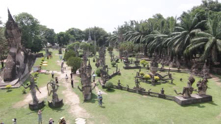vientiane : VIENTIANE, LAOS - April 29: Amazing view of mythology and religious statues at Wat Xieng Khuan Buddha park. April 29, 2017 in Vientiane, Laos. Stock Footage