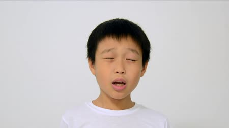 menino : Asian boy sneeze on white background. Vídeos
