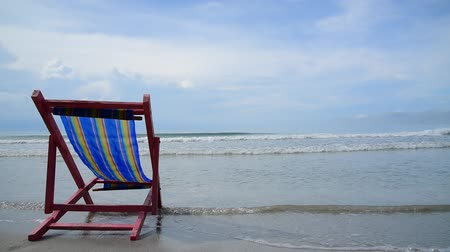 стулья : Pink beach chair at the close of the white sand beach on Thai island