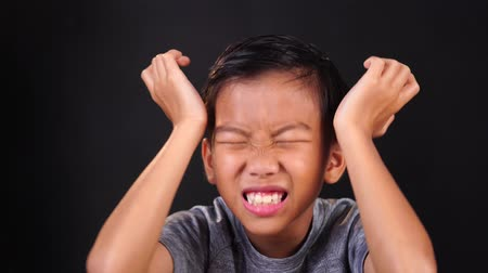 diarrhea : 4k Young Asian boy feel pain at his head and brain. Stock Footage