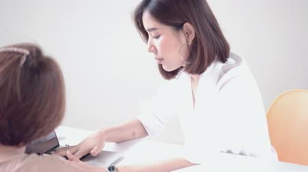 4k Young Asian woman discuss in front of computer laptop