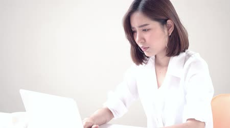 Young Asian woman working with computer 影像素材