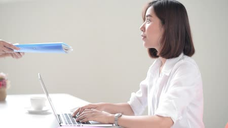 Happy Young Asian woman working with computer laptop