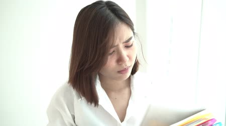 4k unhappy working woman walk and carry file folder in office 影像素材
