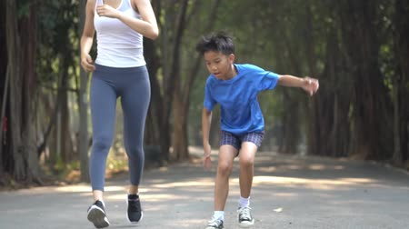 Slow motion Young Asian boy and girl get tired after running