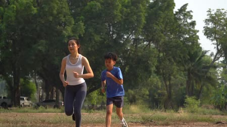 Slow motion, young boy running with young girl Stockvideo