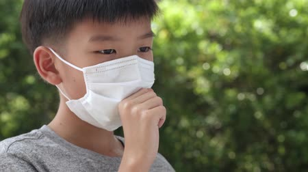 Asian boy wearing a face mask to protect virus and pollution
