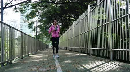 jogging : Young asian woman running on sidewalk in morning. Health conscious concept with copy space. Fitness sport people and healthy lifestyle concept.
